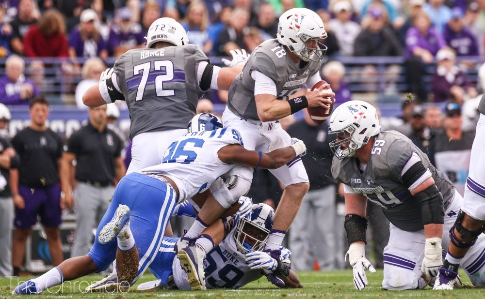 Duke's defense combined for four sacks, six tackles for loss and two interceptions, all of which made it a long day for Northwestern's two quarterbacks.