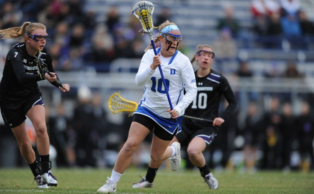 <p>Sophomore Kyra Harney scored two goals Saturday night, but No. 18 Southern California forced the Blue Devils into 14 turnovers and kept Duke scoreless for long stretches in an 11-5 Trojan victory.</p>