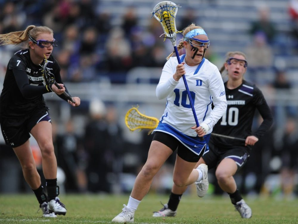 Sophomore Kyra Harney scored two goals Saturday night, but No. 18 Southern California forced the Blue Devils into 14 turnovers and kept Duke scoreless for long stretches in an 11-5 Trojan victory.