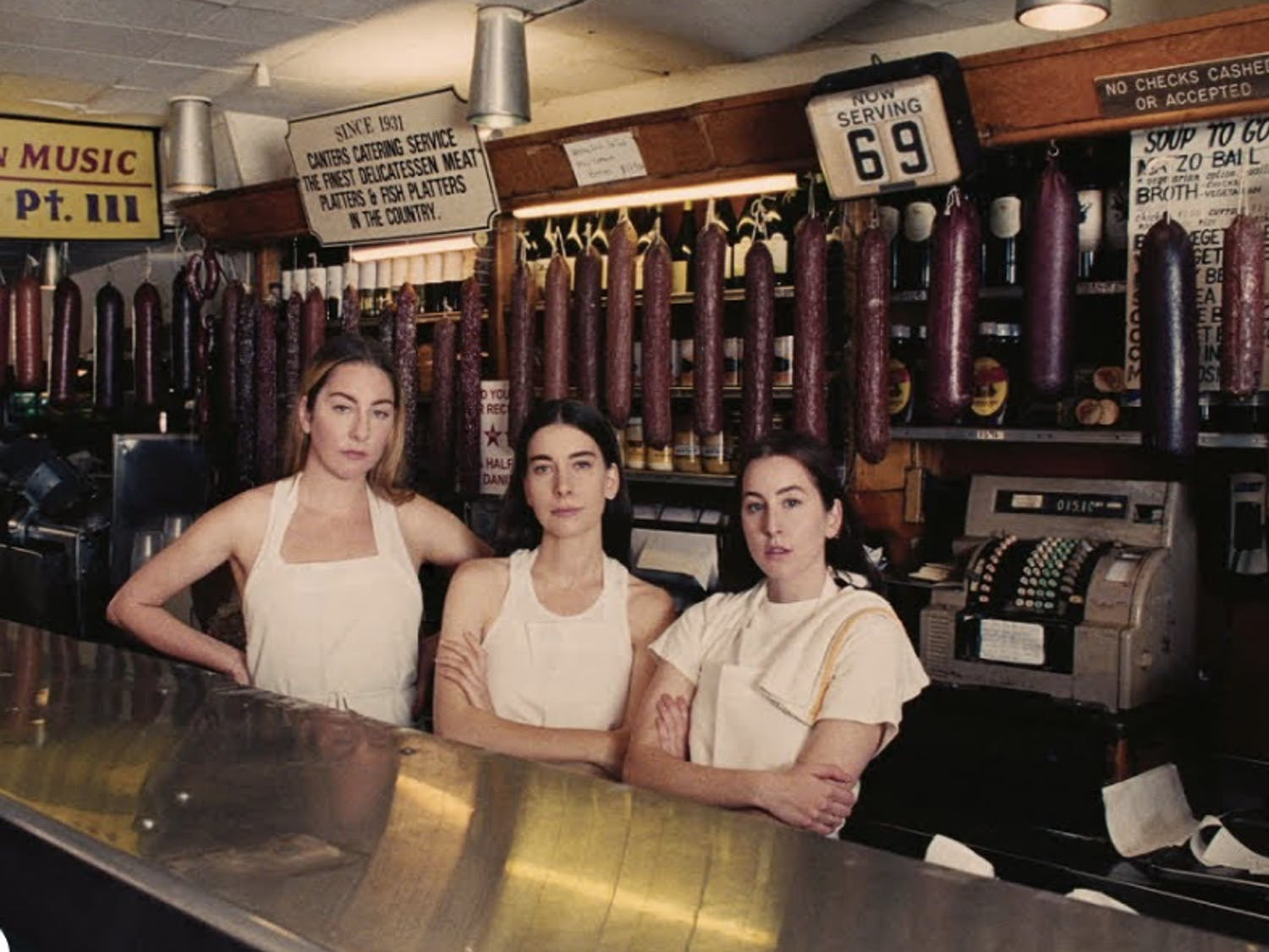 """Long-time friends and now collaborators Taylor Swift and the members of the sister-fronted band HAIM make sparks fly in their new track """"Gasoline""""."""