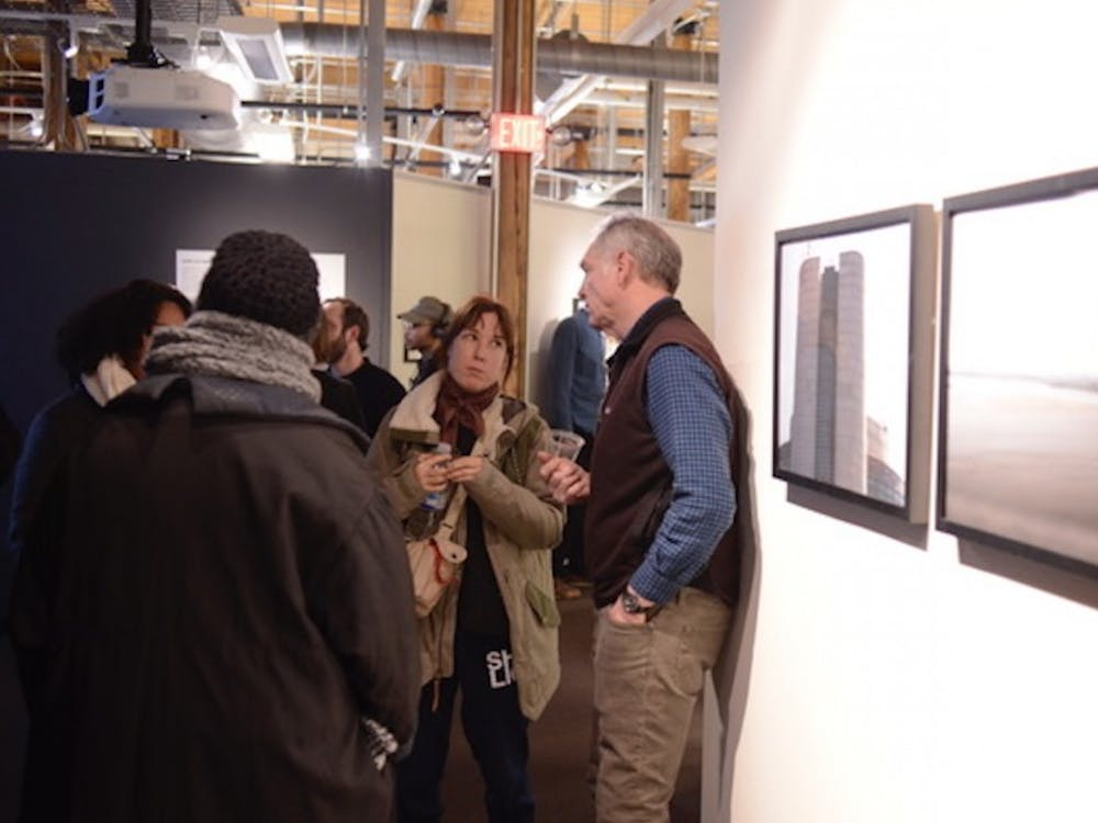 """Last Friday's opening reception for """"Looking North,"""" now on display in Smith Warehouse Bay 11."""