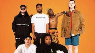 """BROCKHAMPTON continues to mature and evolve over their penultimate album, the surprisingly dark """"ROADRUNNER: NEW LIGHT, NEW MACHINE."""""""