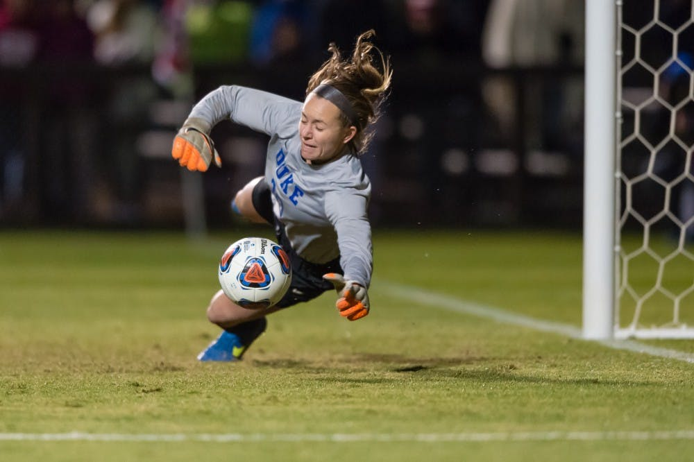 <p>Sophomore goalkeeper E.J. Proctor made two critical saves during penalty kicks Friday night to send the Blue Devils to the College Cup.</p>