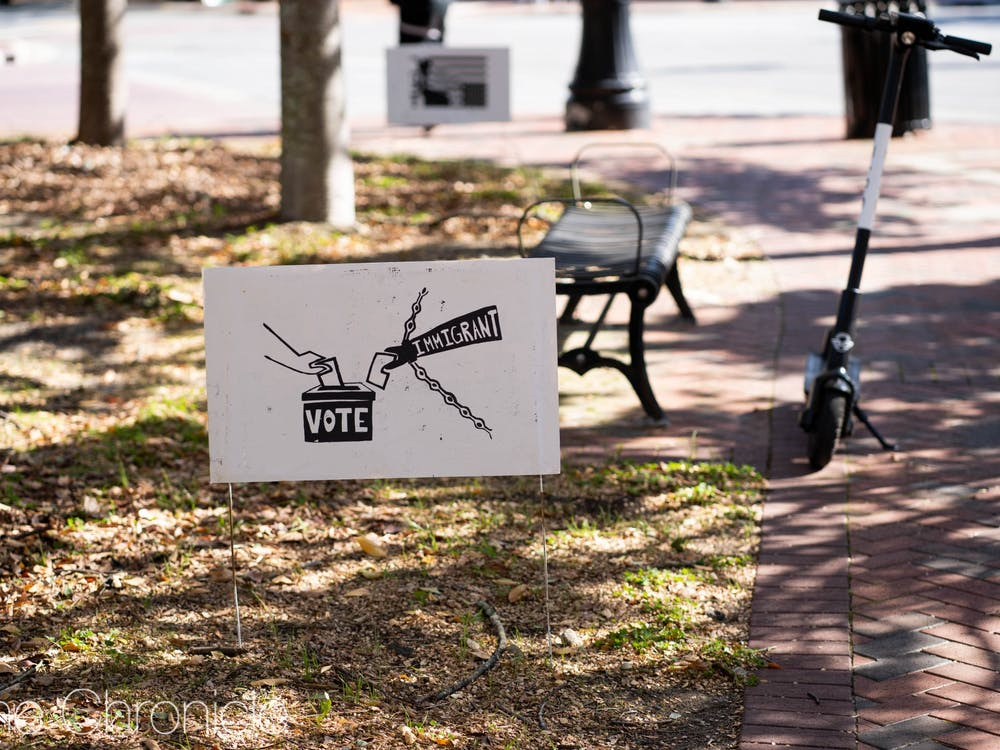 On Election Day 2020, Nov. 3, associate photography editors Lydia Sellers and Henry Haggart went into Durham to capture the scene. The City of Durham urged its residents to mail in votes through signage posted throughout the city, and voting centers on Election Day had shorter lines than usual. But for those who did vote in-person, Durham aimed to make voting as accessible as possible, with both free Lyft and Spin scooter rides to the polling centers and handouts of snacks and masks at the centers. (This gallery has been updated to remove a photo that was not taken on Election Day.)