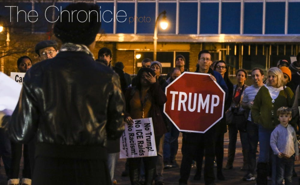 <p>Durham residents gathered to protest President Donald Trump's inauguration Friday evening.&nbsp;</p>