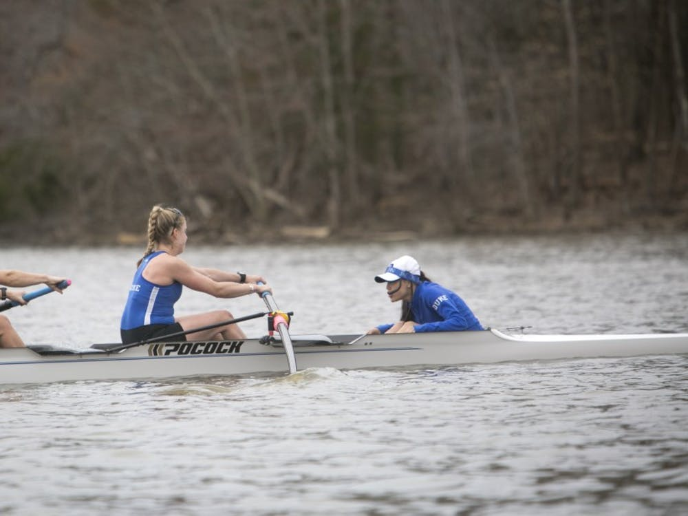 The Duke Rowing team photo and action photos on Lake Michie.