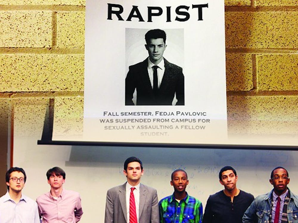 Duke Student Government, meeting shown at bottom, cannot verify the disciplinary records of candidates. The question surfaced after the flyer above accused Fedja Pavlovic of sexually assaulting a student.
