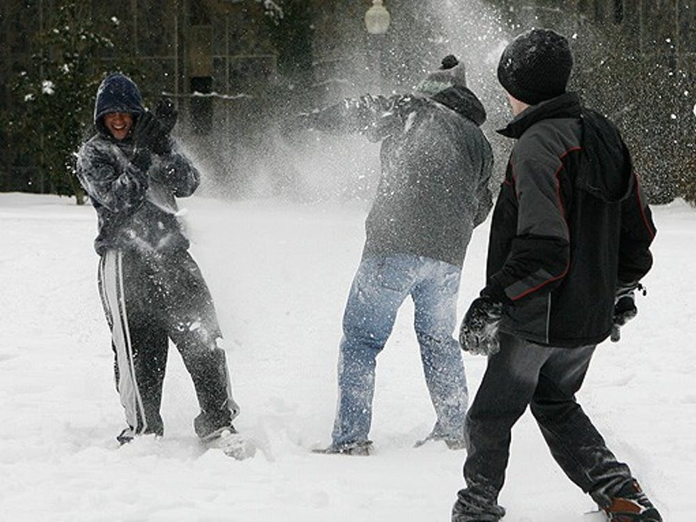 As the University activated its severe weather and emergency policy Saturday morning, many students enjoyed the unusual snow by building snowmen and other wintry activities.