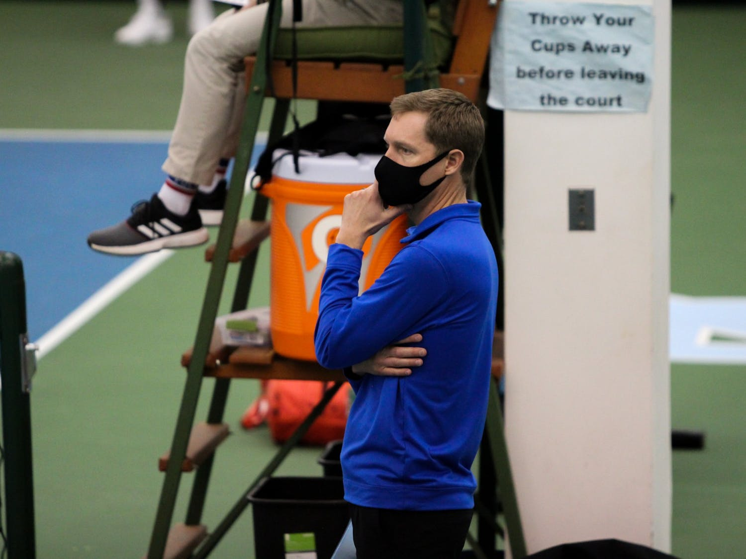 Head coach Ramsey Smith watches on during Duke's first dual meets of the season.