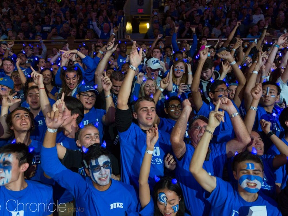 """The student section comes alive as """"Everytime We Touch"""" palys before the player introductions."""