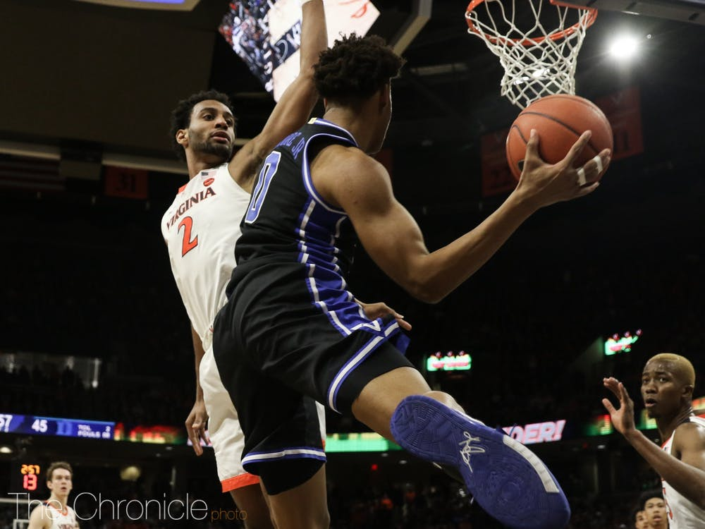 The men's basketball team lost a tight game to Virginia on Feb. 29, 2020. Photos by Bre Bradham, associate photography editor.