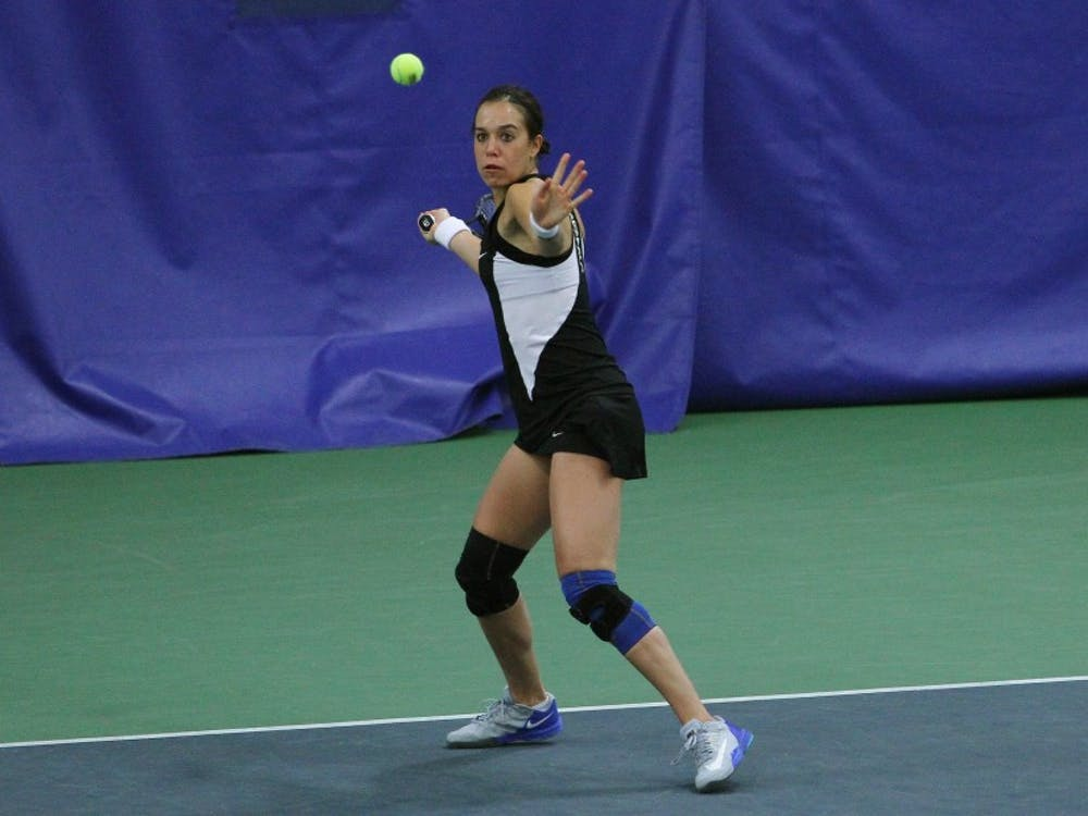 Playing as the Blue Devils' top seed, Capra was the first to finish her match, winning 6-1, 6-0.
