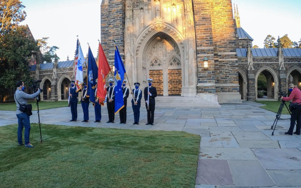 <p>The DBS team taping Veterans Day ceremony in front of the chapel.</p>