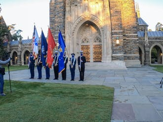 The DBS team taping Veterans Day ceremony in front of the chapel.