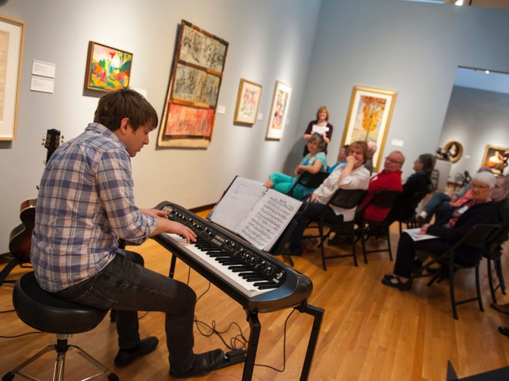 Mark Wells performs in the Nasher galleries for the Reflections program.