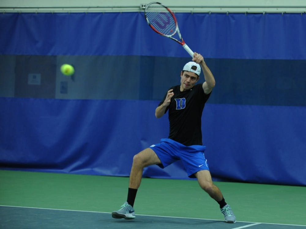 In the Blue Devils' last match, senior Raphael Hemmeler joined head coach Ramsey Smith as one of five players in program history to reach the 100-win plateau in both singles and doubles play.