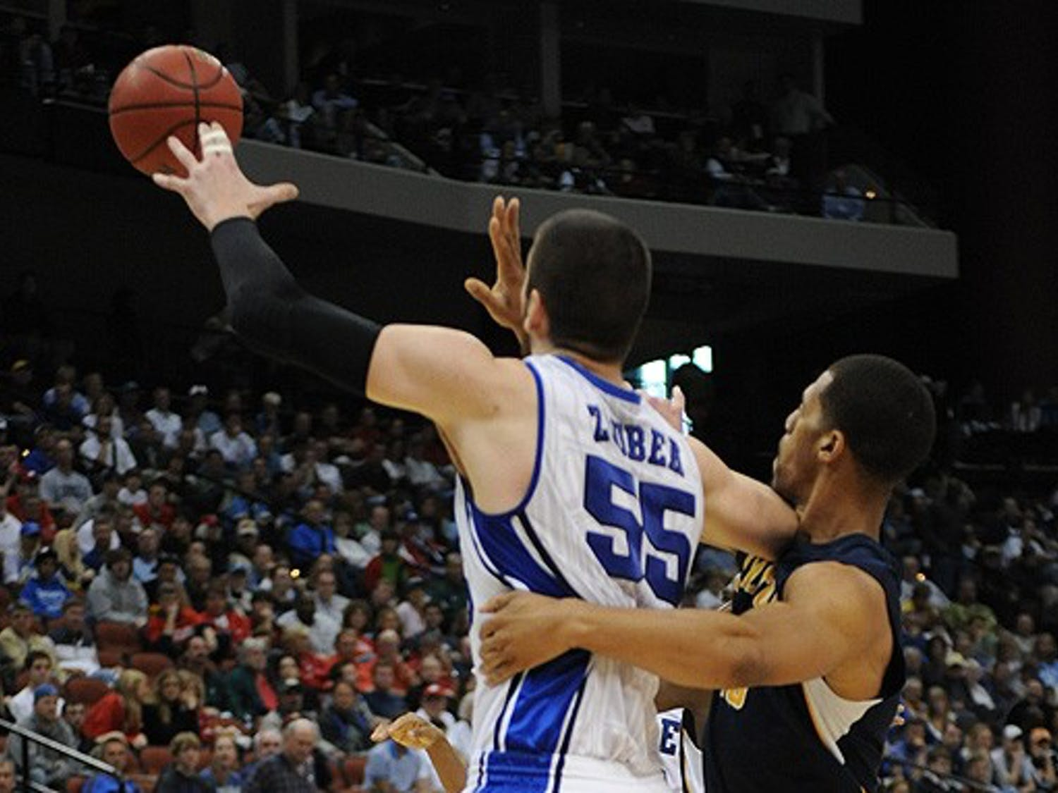 Senior Brian Zoubek would have to contend with big man Omar Samhan if Duke faces St. Mary's in the Elite Eight.