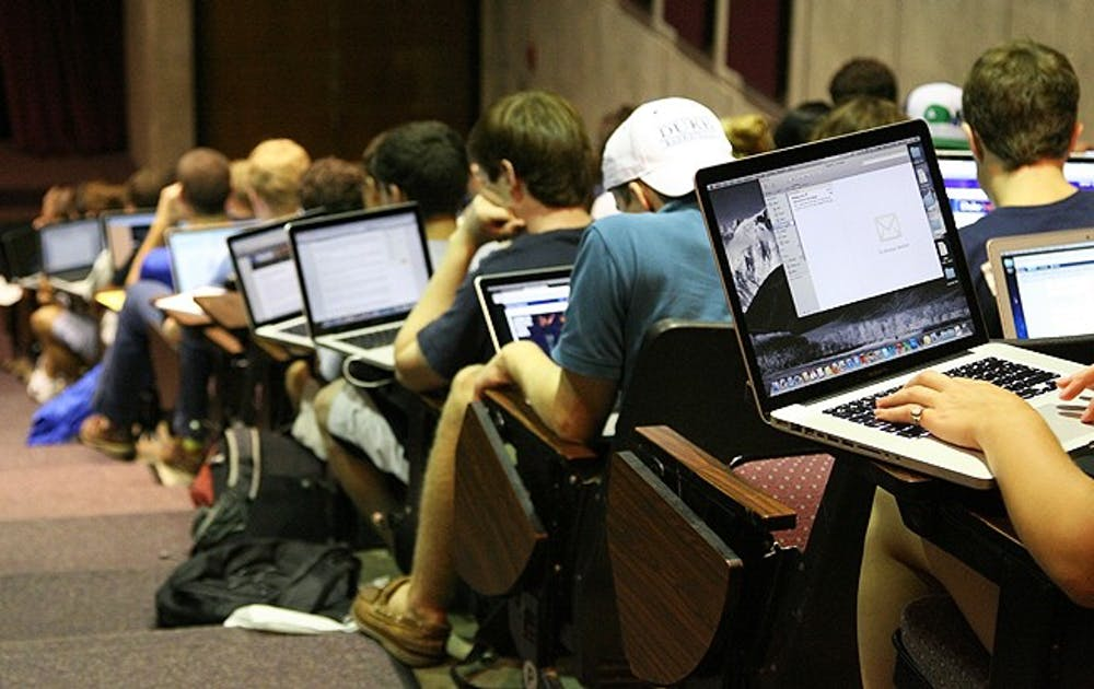 Despite the increasing role of technology in higher education, more professors are banning the use of laptops in classrooms in an effort to hold students' attention.