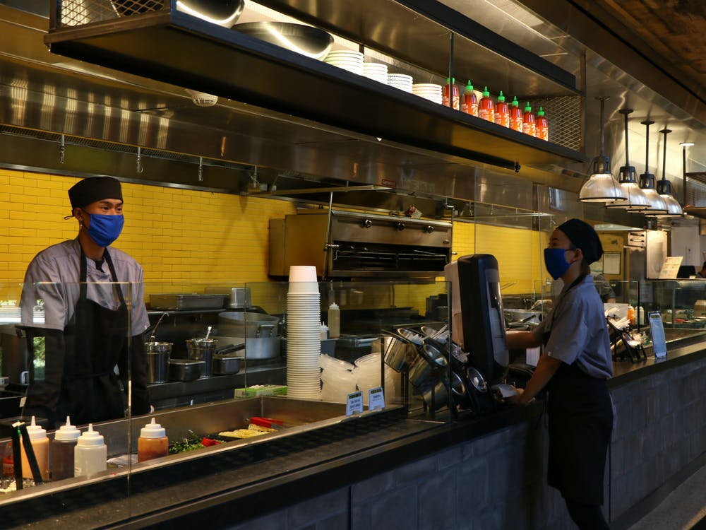 <p>Workers at Ginger &amp; Soy in the Brodhead Center.</p>