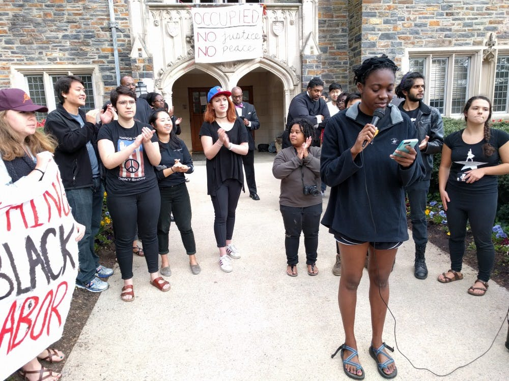 The eight students read statements after exiting the Allen Building.