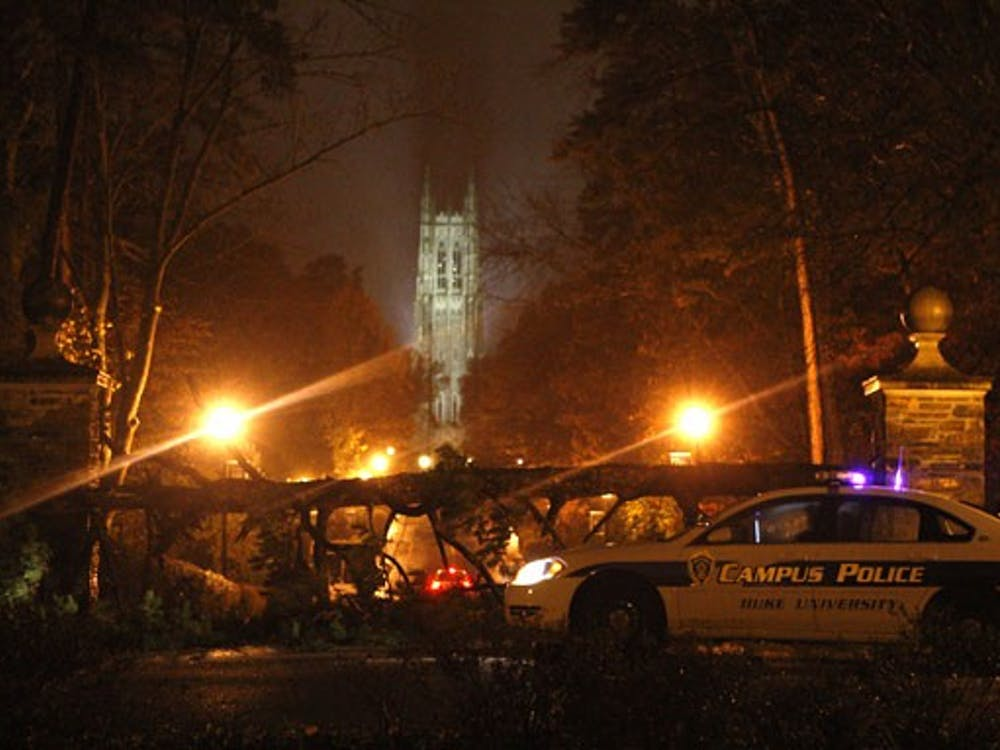 A fallen tree obstructs traffic on Chapel Drive Wednesday night. The inclement weather, caused by Tropical Storm Ida, brought down several trees on campus, including one in front of Wilson dormitory on East Campus. The rain is expected