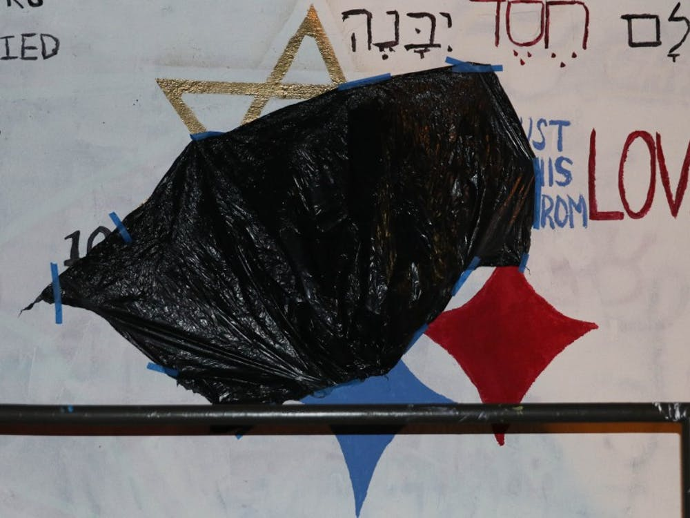 By 1 a.m. Monday morning, the swastika had been covered up by a trash bag.