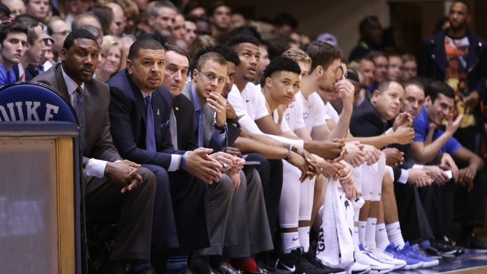 Associate head coach Jon Scheyer (fourth from left) touched on a variety of topics Friday morning.