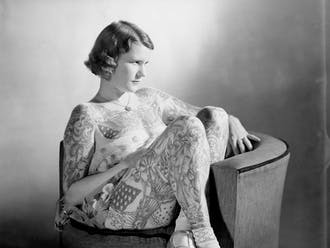 """Women such as Betty Broadbent (above) were put on display in circuses and sideshows as """"The Tattooed Lady"""" in the early 1900s."""