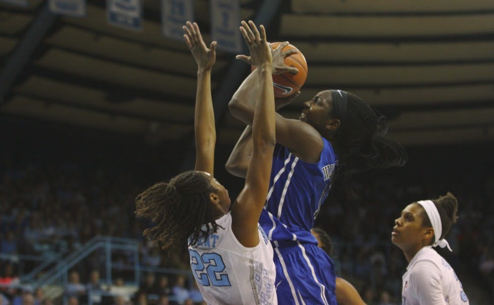 Senior Elizabeth Williams scored a career-high 33 points and led the Blue Devils in their overtime victory Sunday.