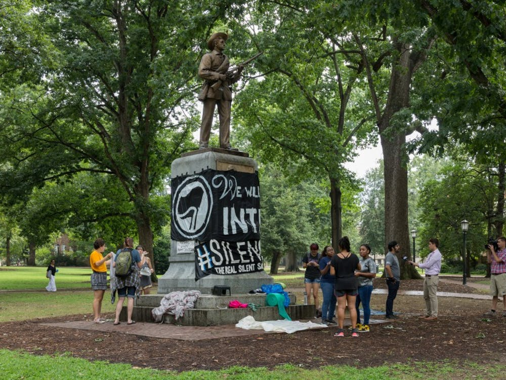 Photo from a protest at the statue before it was pulled down by protesters