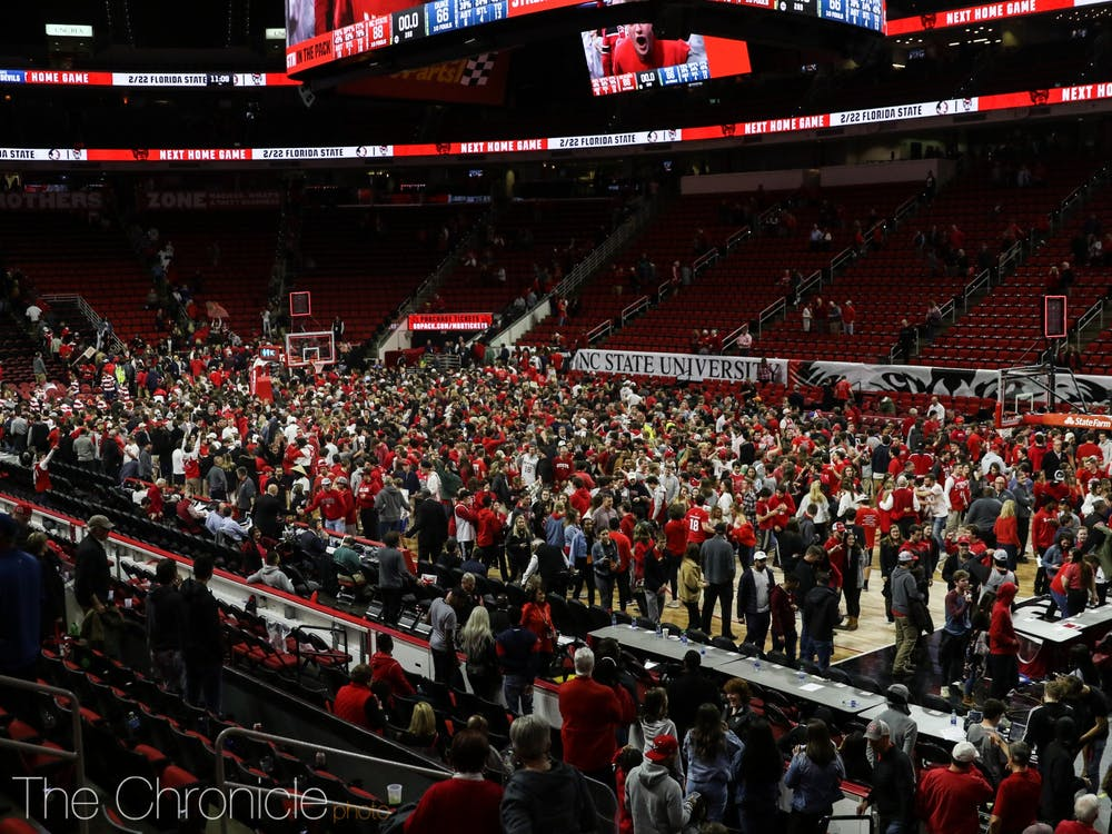 <p>Wolfpack fans stormed the court after the N.C. State win.&nbsp;</p>