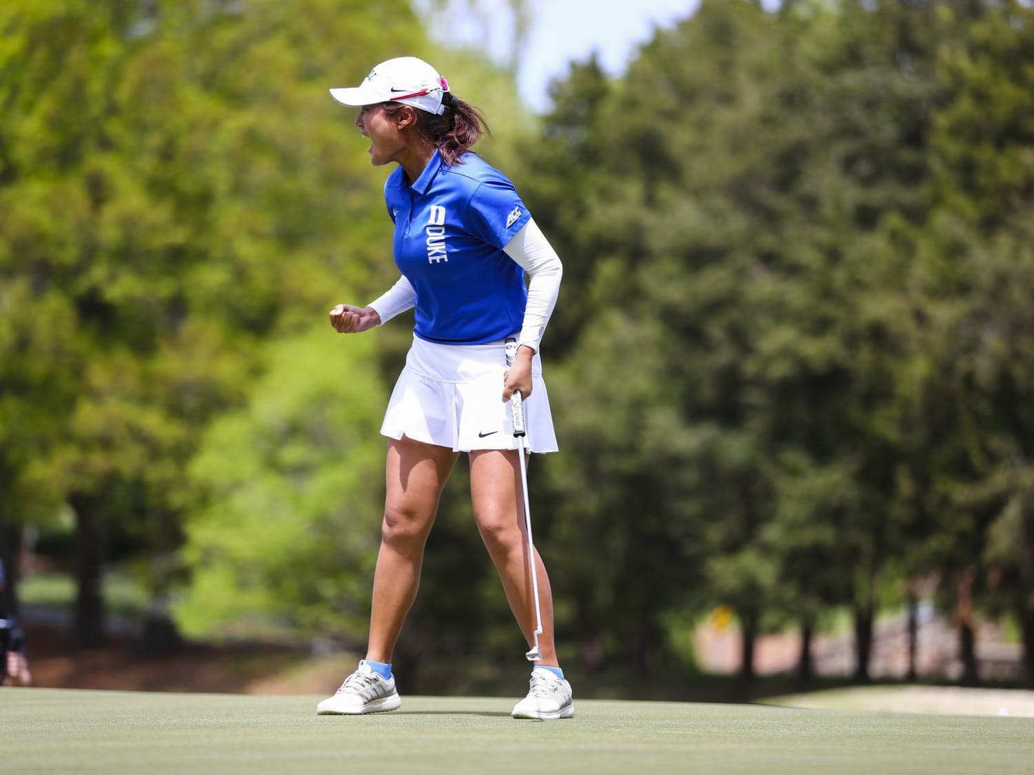 Junior Gina Kim secured the individual ACC title while also sinking the clinching put for the team championship.