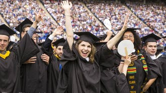 Students celebrate at Duke's commencement ceremony in 2019.
