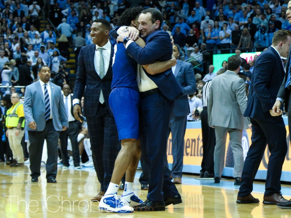 <p>Tre Jones and head coach Mike Krzyzewski embrace after an improbable win in Chapel Hill.</p>
