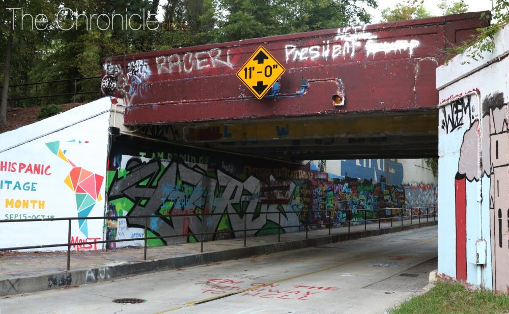 <p>The slurs were found Sunday afternoon under the East Campus bridge but have since been painted over.</p>