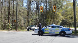 DUPD officers were stationed along Duke University Road Tuesday afternoon during the search for a suspect.
