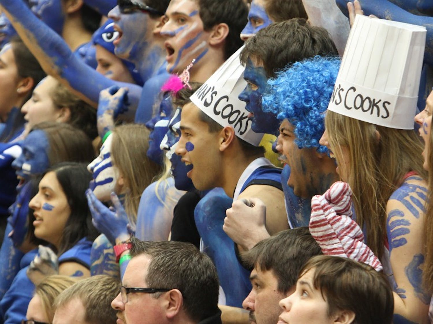 """Senior Matt Pun, pictured middle in the """"Quinn's Cooks"""" hat, served as sports managing editor."""