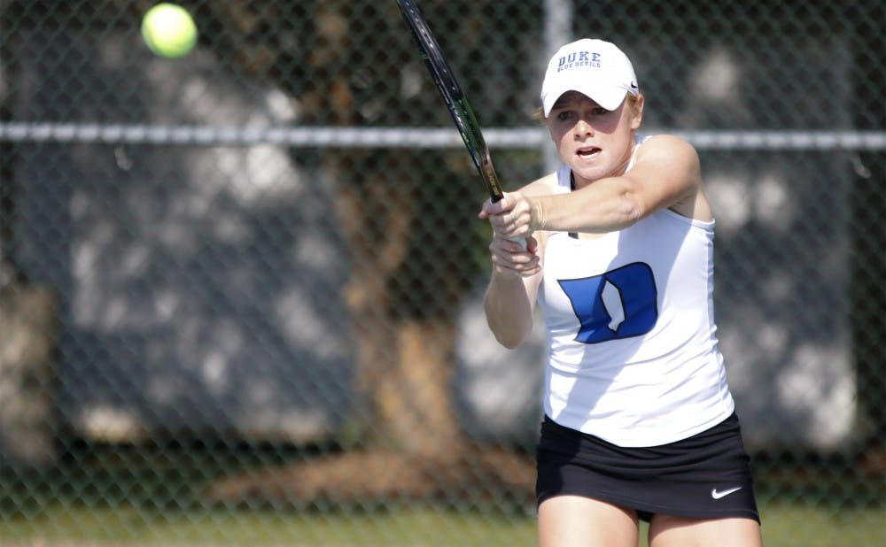 <p>Duke junior Alyssa Smith teamed with classmate Chalena Scholl to knock off their Vanderbilt counterparts in doubles action Friday, but it did not prevent the Commodores from capturing the doubles point.</p>