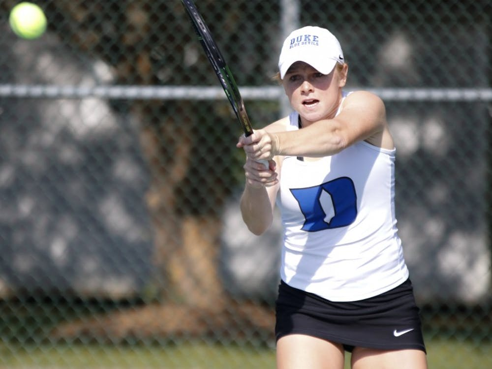 Duke junior Alyssa Smith teamed with classmate Chalena Scholl to knock off their Vanderbilt counterparts in doubles action Friday, but it did not prevent the Commodores from capturing the doubles point.