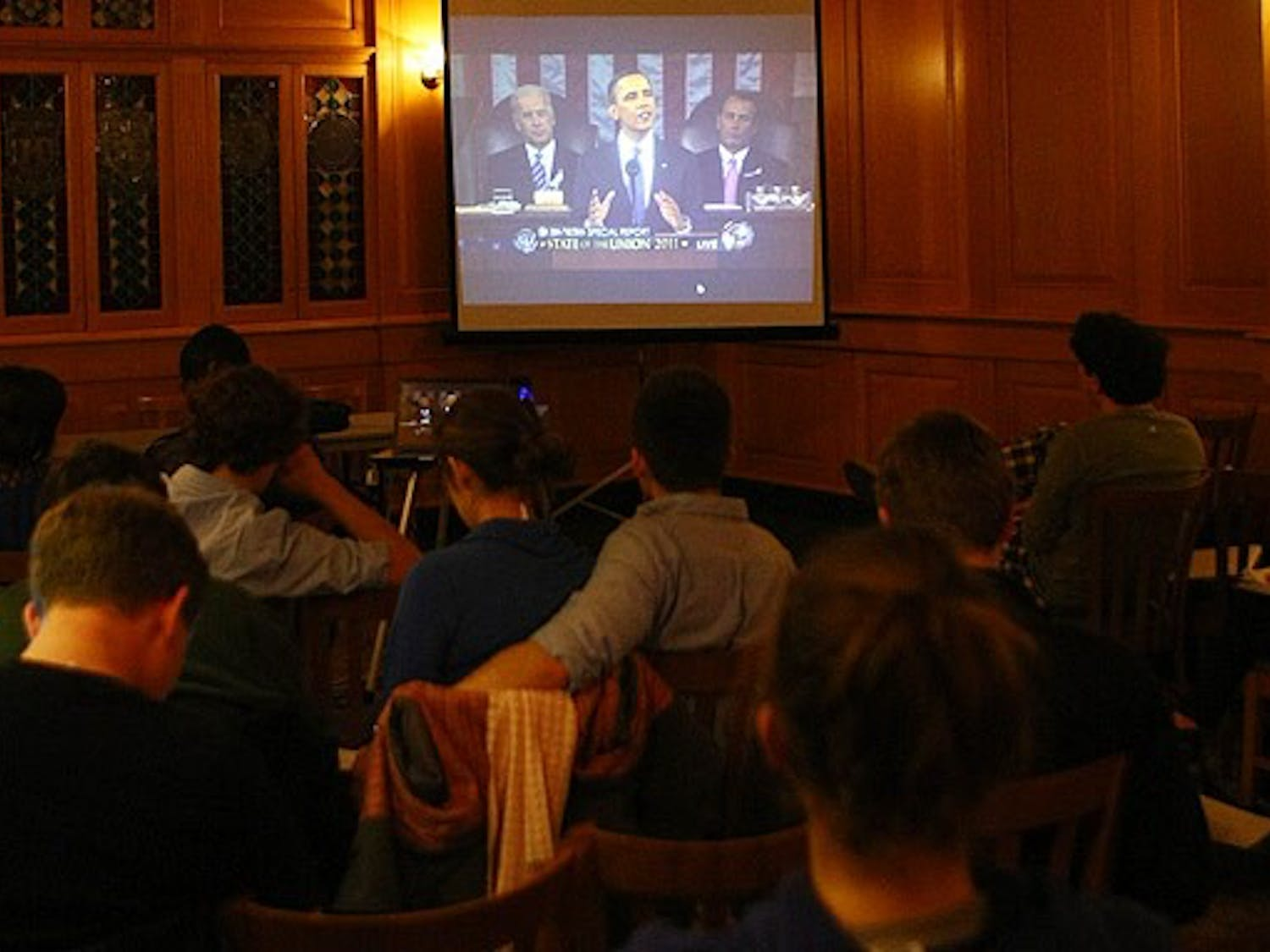 Students watch from the Old Trinity Room as President Barack Obama delivers his State of the Union address, which focused on innovation and the importance of American economic advancement.
