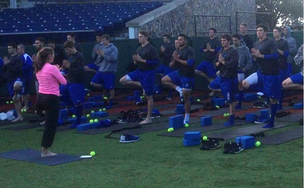 Under the direction of Kathy Sell Smith, the Blue Devils have embraced yoga as part of their practice routine.