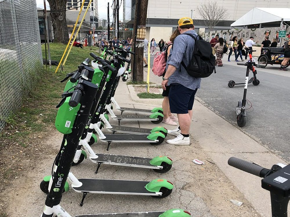Lime scooters lined up, just as they will be in spots around Durham. Courtesy of Flickr.