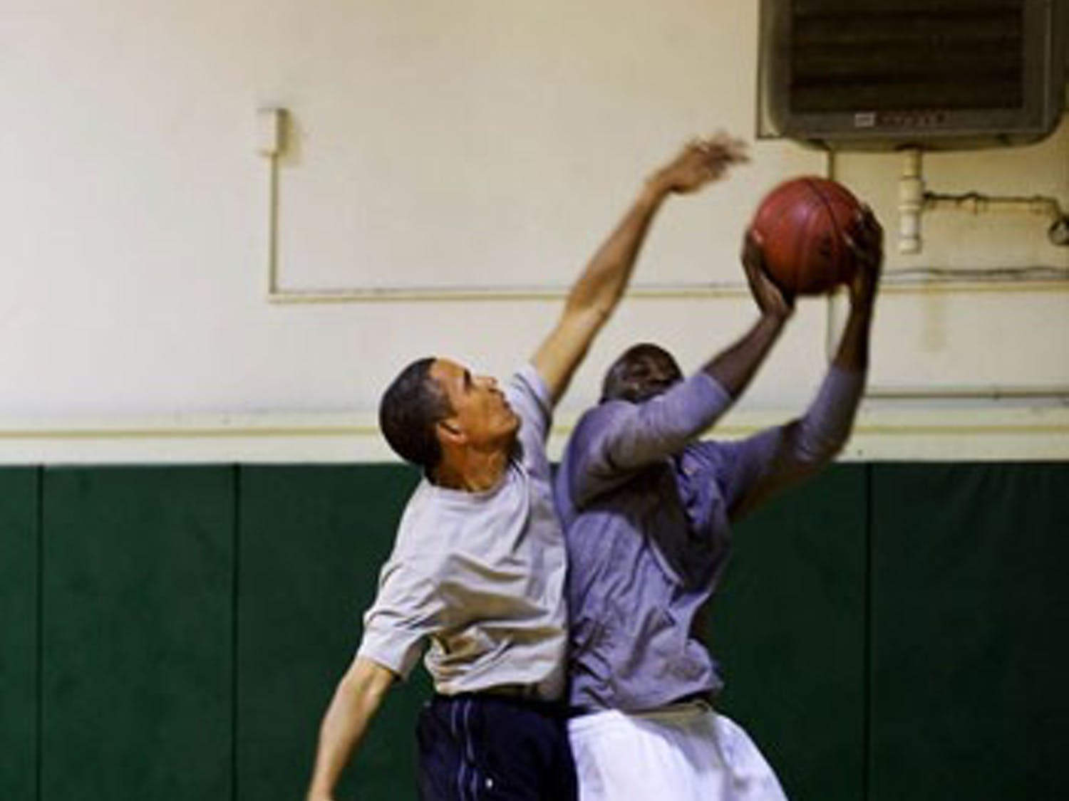 President Barack Obama plays basketball with personal aide Reggie Love at St. Bartholomew (St. Bart's) Church in New York, N.Y. on Sept. 23, 2009.   