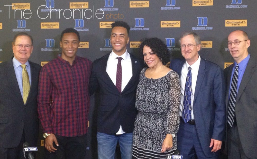 <p>Blair Holliday (center) will participate in Sunday's commencement ceremony after nearly losing his life in July 2012. </p>
