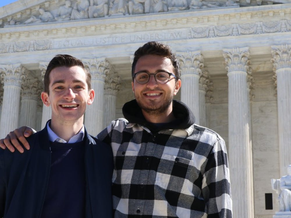 Seniors Luke Farrell, left, and Jake Shulman traveled to D.C. to hear the case.