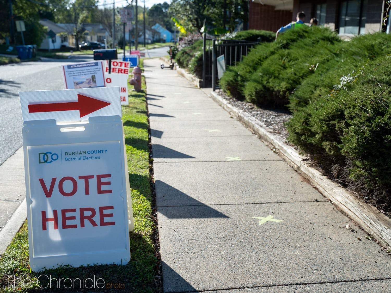 Signs marking the 5th precinct voting site at the WI Patterson Community Center line Crest Street.