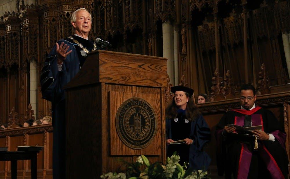 <p>President Brodhead presented the University Medal to custodian Oscar Dantzler and former Trustee Bruce Karsh Thursday.</p>