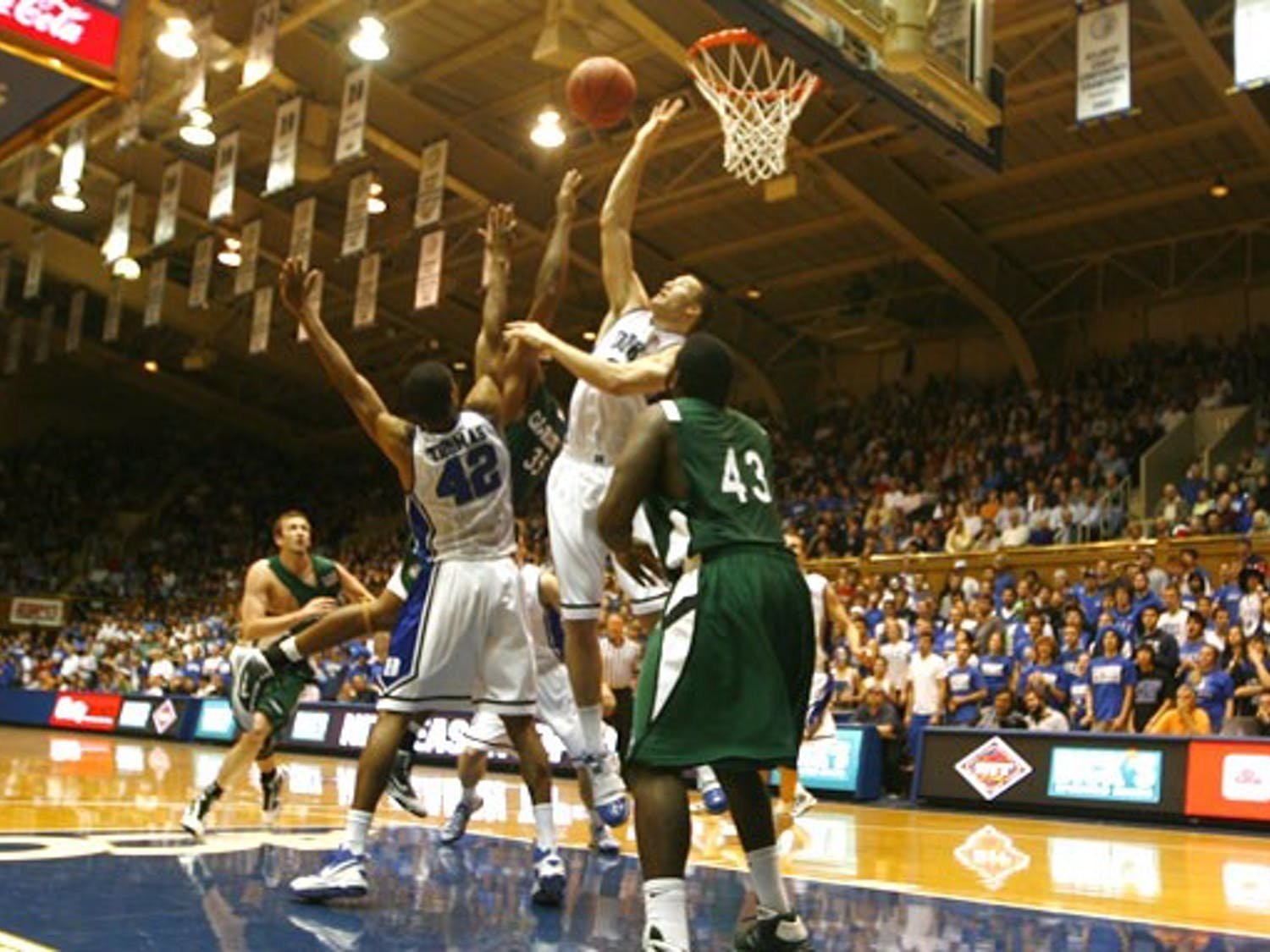 Lance Thomas (left), Miles Plumlee and the rest of the Duke defense held Charlotte to under 34 percent shooting in Tuesday's easy win.
