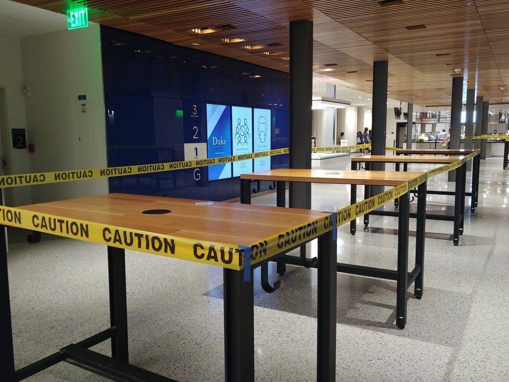 <p>Some of the many tables now closed to students to curb the spread of COVID-19 on campus.</p>