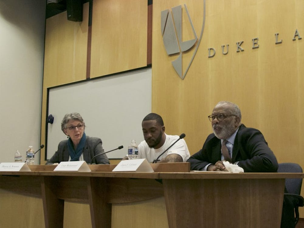 James Coleman and Thersea Newman (far right and far left) serve as co-directors of Duke's Wrongful Conviction Clinic, which investigates incarcerated felons' claims of innocence.